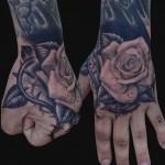 hand rose tattoo design