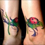 cute ladybug tattoo design on leg