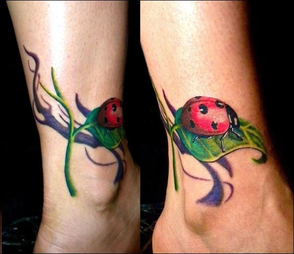 cute ladybug tattoo design on leg