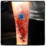 phoenic feather tattoo design on arm