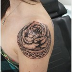black rose tattoo on shoulder