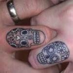 skull and flowers wedding ring tattoo design