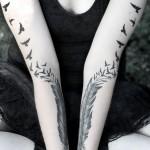 symmetrical feather tattoo design