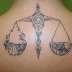 tribal libra tattoo on back