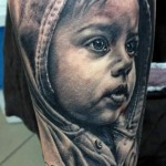 Andy Engel baby portrait tattoo design