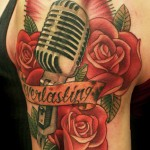 Niki Norberg colorful realistic rose tattoo