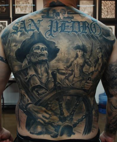 Carlos Torres full back skull tattoo