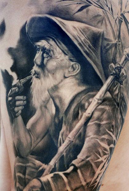 Carlos Torres black portrait tattoo
