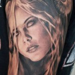 Carlos Torres portrait tattoo on sleeve