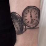 Niki Norberg realistic clock tattoo