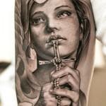Niki Norberg realistic portrait tattoo