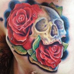 Andres Acosta skull and roses tattoo