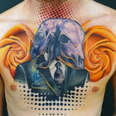 Andres Acosta skulls and yellow roses tattoo