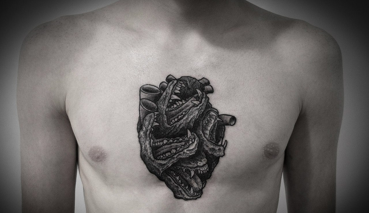 black heart tattoo on chest by Ien Levin - Design of