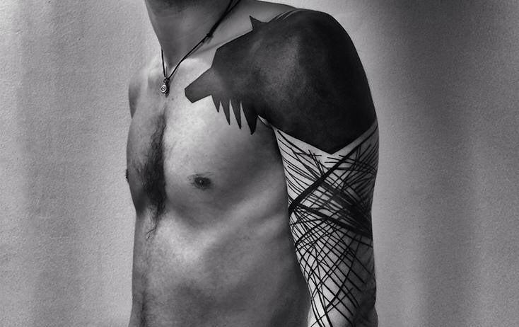Roxx black tattoo designed on shoulder
