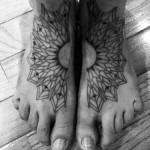 Roxx black tattoo on feet