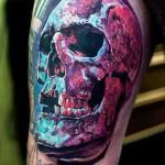Robert zyla colorful skull tattoo on arm