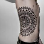 Chaim Machlev cool back tattoo