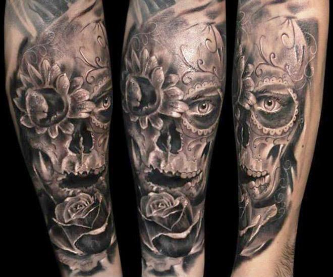 Robert Zyla flower and skull tattoo