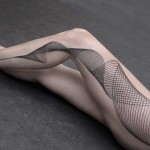 Chaim Machlev leg tattoo