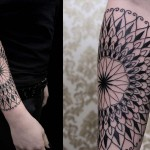 Chaim Machlev patterned black tattoo