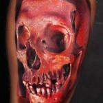 Robert Zyla red skull tattoo