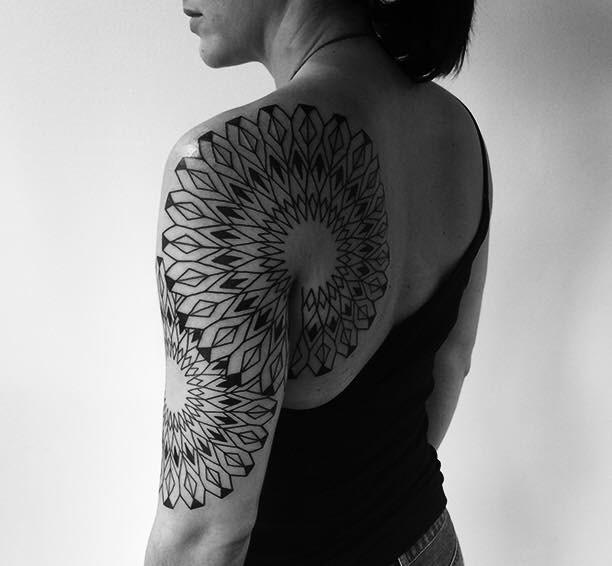 Roxx shoulder and half sleeve tattoo