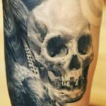Sergio Sanchez realistic skull tattoo