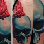 John Anderton red rose and blue skull tattoo