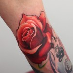 John Anderton rose tattoo on arm