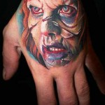Mario Hartmann scary portrait tattoo design on hand