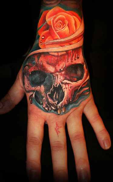 Mario Hartmann skull and roses tattoo