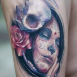 Darwin Enriquez skull and portrait tattoo