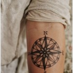 impressive compass tattoo