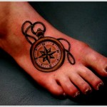 simple compass tattoo design on foot