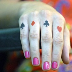 spade tattoo designed on fingers