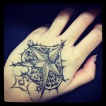 spade tattoo designed on hand