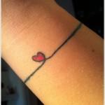 simple heart tattoo on wrost