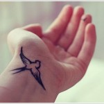 swallow tattoo design on wrist