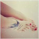 foot swallow tattoo