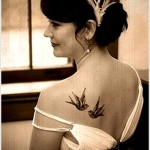 two swallow tattoo design on back