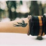 black ink swallow tattoo