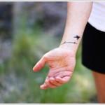 small bird wrist tattoo design