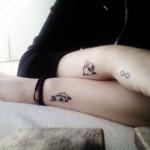 panda bear tattoo on both arms
