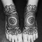 baroque style tattoo designed on feet