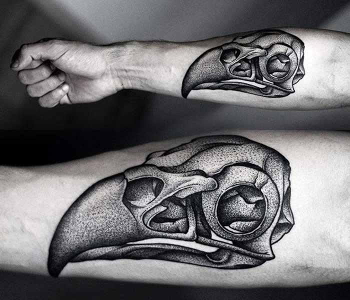 Kamil Czapiga black tattoo designed on forearm