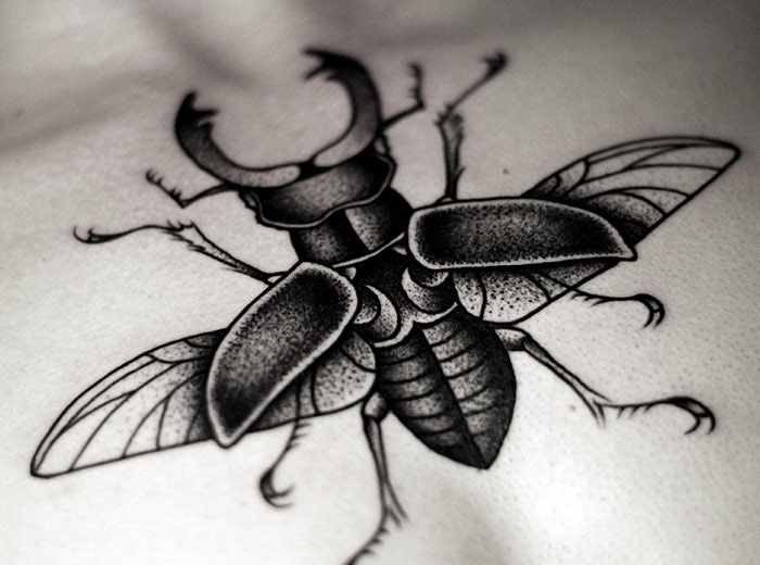 Kamil Czapiga detailed insect tattoo design