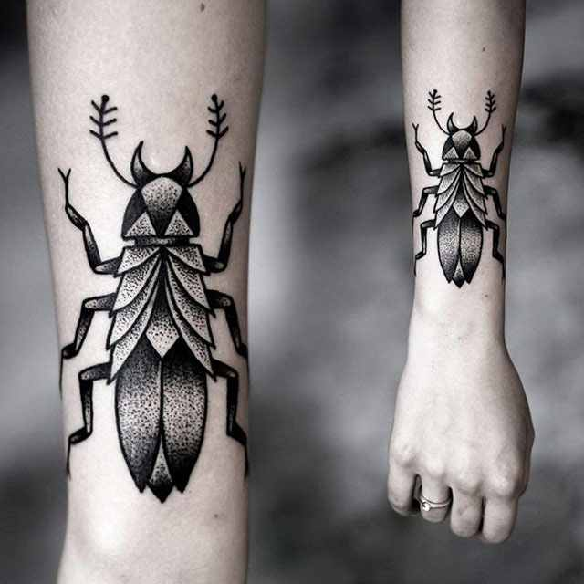 Kamil Czapiga insect tattoo in black