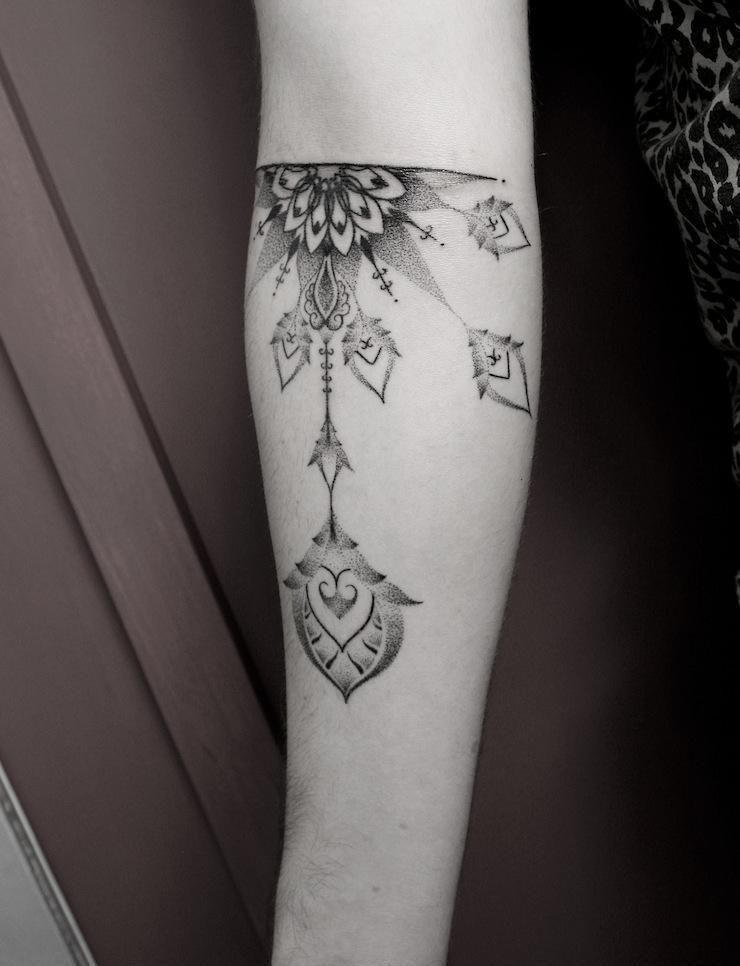 simple black baroque tattoo design