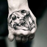Kamil Czapiga skull tattoo on hand